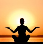 woman-meditating-sunset